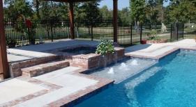 classic-gunite-pool-with-antique-brick-coping-square-spa-spouts-foam-jets-tanning-ledge-diamond-brite-plaster-concrete-deck