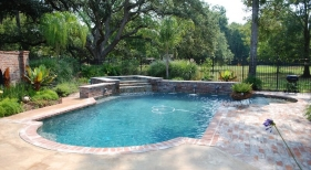 classic-roman-end-pool-with-raised-spa-and-wall-lionhead-spouts-antique-brick-white-gold-quartzite-coping-diamond-brite-french-gray-plaster