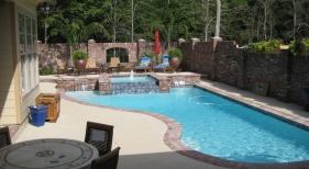 traditional-accented-pool-with-antique-brick-diamond-brite-plaster-spa-raised-wall