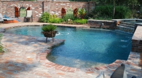 traditional-roman-end-pool-with-tanning-shelf-raised-wall-spa-antique-brick-quartzite-coping-french-gray-plaster-water-features