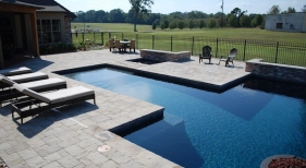 modern-concrete-pool-dark-plaster-baja-shelf-spa-belgard-pavers-antique-brick