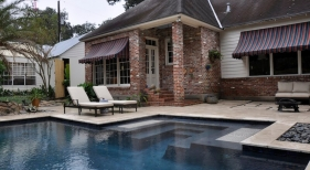 pool-entry-with-perimeter-bench-tanning-ledge-spa-jets-custom-tile-medallions-travertine-coping-dark-blue-plaster