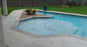 Geometric-pool-with-octagon-shaped-tanning-ledge-bubblers-swim-lane-and-pool-landscaping-1