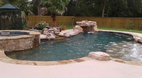 Natural-freeform-pool-with-tanning-ledge-bubblers-loveseat-grotto-raised-spa-and-koi-pond