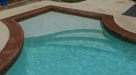 concrete-pool-with-cast-concrete-coping-tanning-ledge-pearl-plaster