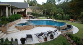 infinity-edge-gunite-pool-shellstone-pavers-cocktail-table-diamond-brite-plaster-multi-level-deck