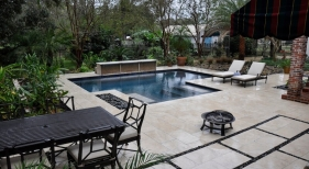 modern-gunite-pool-with-raised-wall-Italian-glass-tile-custom-travertine-mosaic-tanning-shelf-tavertine-deck-Mexican-beach-pebble-french-drain