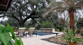 modern-pool-with-raised-barreled-wall-covered-in-Italian-mosaic-glass-tile-rain-waterfall-diamond-brite-cobalt-plaster-traverine-decking