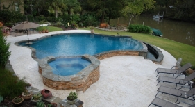 negative-edge-concrete-pool-ledger-stone-wall-raised-spa-diamond-brite-tahoe-blue-plaster