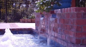 raised-gunite-spa-with-antique-brick-overlay-baja-shelf