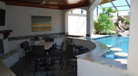 sunken-pool-bar-granite-countetop-travertine-capped-stools