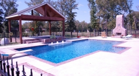 traditional-gunite-diving-pool-with-raised-spa-tanning-ledge-diamond-brite-plaster-cabana