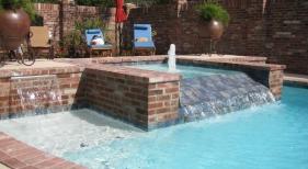 traditional-pool-with-antique-brick-blue-ceramic-tile-diamond-brite-quartz-plaster-spa-fountain
