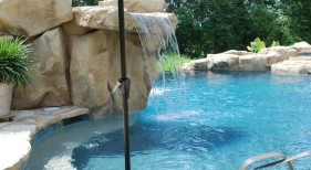 gunite-pool-with-granite-cocktail-table-rico-rock-waterfall-pebble-plaster-umbrella-holder