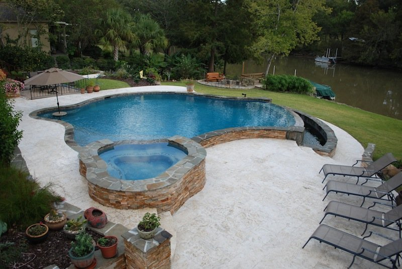 Broussard pool design lafayette outdoor living youngsville for Raised pool designs