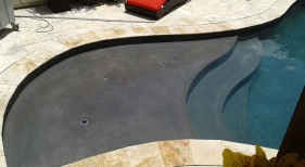 Custom-modern-pool-with-tanning-ledge-deck-jets-sheer-descents-waterfall-travertine-decking-2