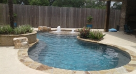 Freeform pool, flagstone coping, beach entry, rico rock boulders, bubblers and raised planter box (1)
