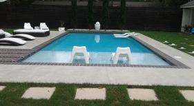 Geometric-pool-with-separate-spa-bullnose-brick-coping-and-grass-landscaping