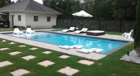 Geometric-pool-with-separate-spa-bullnose-brick-coping-and-grass-landscaping1