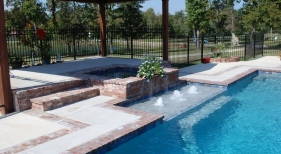 classic-gunite-pool-with-antique-brick-coping-square-spa-spouts-foam-jets-tanning-ledge-diamond-brite-plaster-concrete-deck