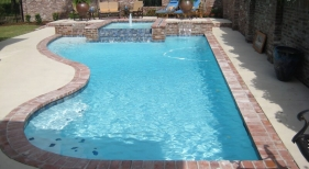 classic-light-colored-pool-diamond-brite-blue-quarts-plaster-spa-sheer-descent-raised-wall-antique-brick