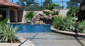 custom-gunite-lagoon-pool-beach-entry-tanning-ledge-laminar-jet-rico-rock-slide-waterfall-pebble-plaster-finish
