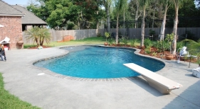 gunite-lagoon-pool-with-diving-board-tanning-ledge-benches-diamond-brite-french-gray-plaster