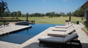 modern-gunite-vanishing-edge-pool-belgard-pavers-raised-wall-dark-plaster-grand-effects-fire-bowls