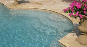 pool-entry-with-wedding-cake-steps-and-bench-extensions-gold-travertine-coping-and-deck-diamond-brite-super-blue-plaster